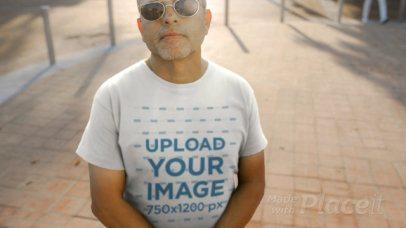 Tee Video Maker of a Cool Older Man Wearing a T-Shirt at Sunset 12747