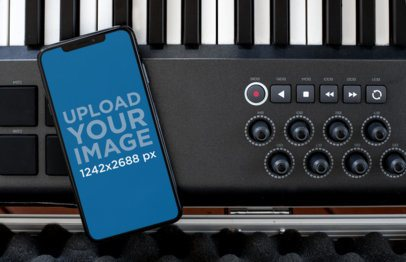 iPhone XS Max Mockup Lying over a Musical Keyboard 25614