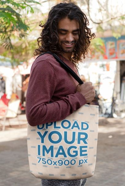 Mockup Featuring a Man With Long Trendy Hair Carrying a Tote Bag 26701
