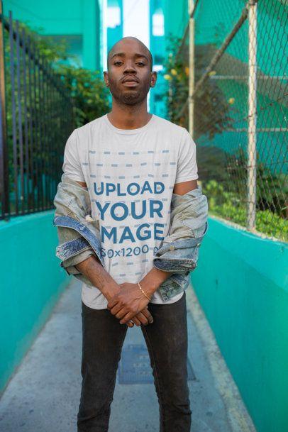 T-Shirt Mockup of a Badass Man Posing in an Alley 26319