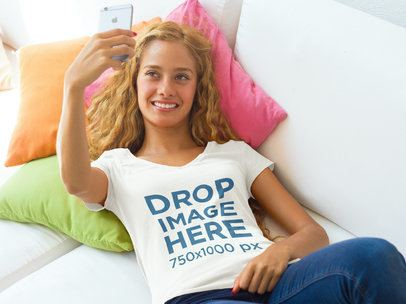 T-Shirt Mockup Featuring a Young Woman Taking a Selfie a7797