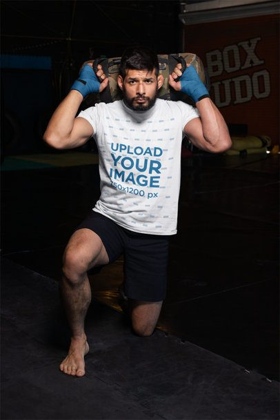 T-Shirt Mockup of an Mma Fighter Kneeling at a Boxing Gym 26252