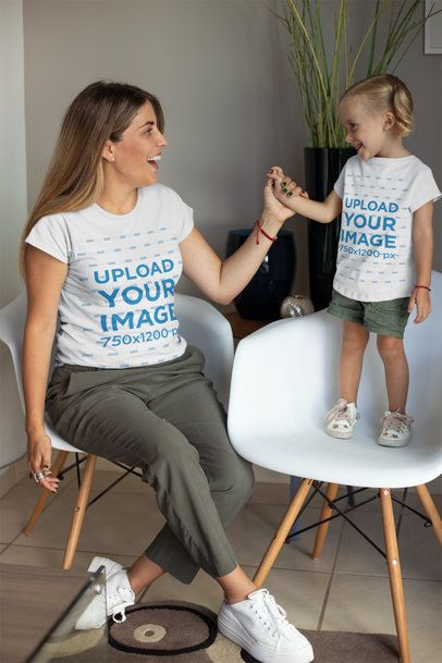Mockup of a Mommy and Her Little Daughter in Matching Outfits at Home 26490