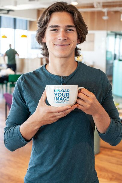 Mockup Featuring a Smiling Young Man Holding a Coffee Mug Close to Him 26503