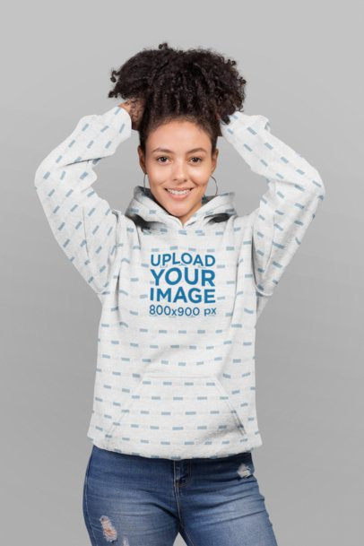 Mockup of a Flirty Woman Wearing a Pullover Hoodie in a Studio 23962