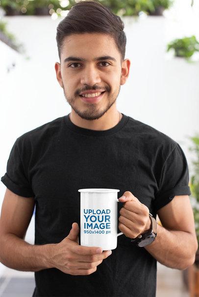 Mockup of a Smiling Bearded Man Holding a 21 Oz Enamel Coffee Mug 26935