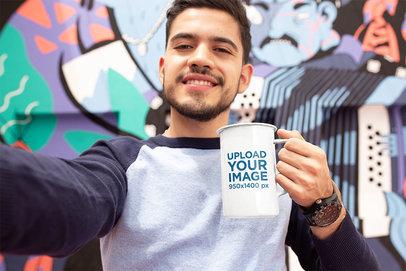 Mockup of a Man Taking a Selfie with a 21oz Enamel Coffee Mug 26937