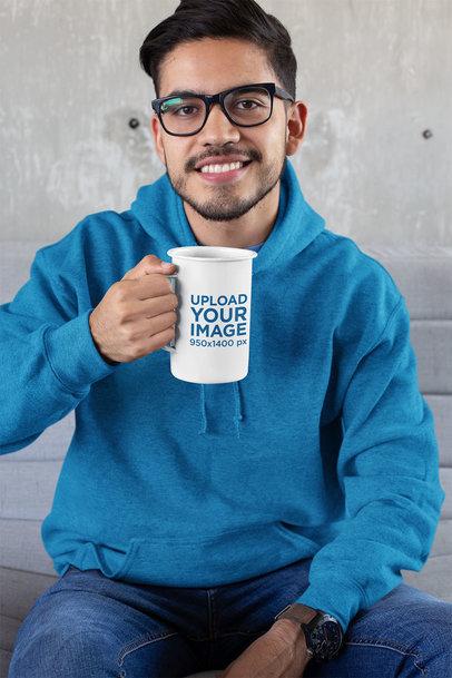 21 Oz Enamel Mug Mockup of a Man with Glasses Sitting against a Concrete Wall 26940
