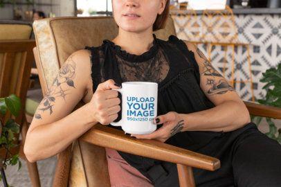 Mockup of a Tattooed Young Woman Holding a 15 Oz Mug 27242