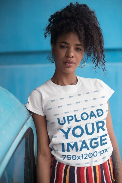 T-Shirt Mockup of a Young Woman with Curly Hair in a Blue Urban Scenario 27349