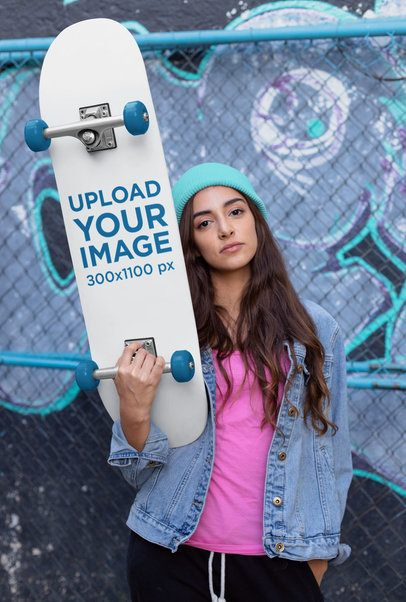 Skateboard Mockup of a Young Woman Against a Chain Link Fence 27120