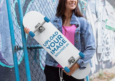 Skateboard Mockup Featuring a Woman with a Denim Jacket Against a Graffitied Wall 27121