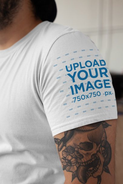 Mockup of a T-Shirt Side View Featuring a Tattooed Man 27148