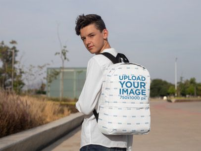 Mockup of a Teenager with a Backpack Looking at the Camera 27698