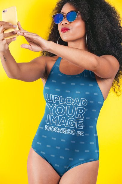 Swimsuit Mockup Featuring a Woman with Sunglasses Taking a Selfie 26577