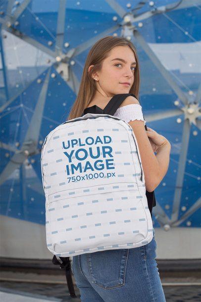 Mockup of a Female Teenager Carrying a Backpack over Her Shoulder 27709
