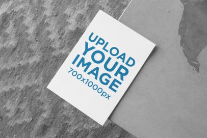 a5 Flyer Mockup Lying on a Textured Gray Surface 27420