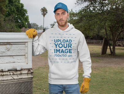 Mockup of a Ranch Worker Wearing a Hoodie and a Trucker Cap 27961