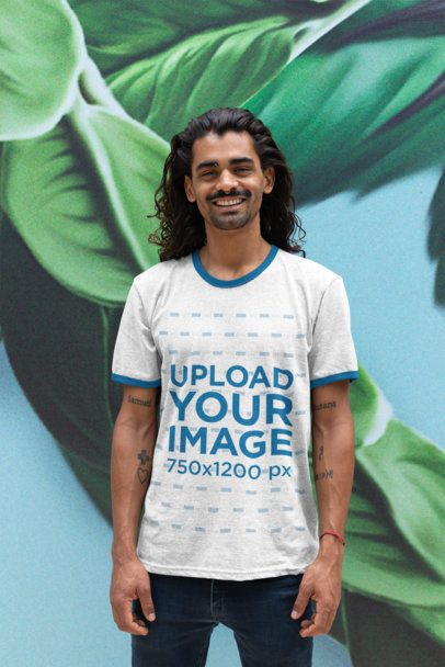 Ringer T-Shirt Mockup of a Man Against a Tropical Leaves Wallpaper 27906