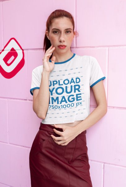 Crop Top Ringer Tee Mockup of a Red Haired Woman Against a Pink Background 27262