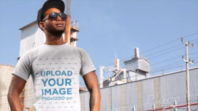 T-Shirt Video of a Trendy Man Standing Outside a Factory 12878