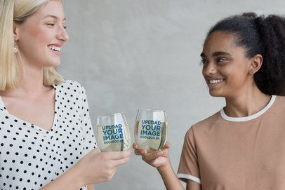 Mockup of Two Women Toasting with Stemless Wine Glasses 27950