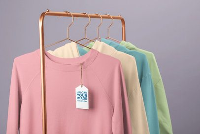 Clothing Tag Mockup Featuring a Rack of Crewneck Sweatshirts 27666