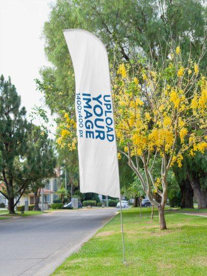 Mockup of a Flag Banner at a Park 28013