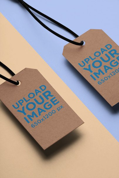 Mockup of Two Brand Tags Over a Two-Colored Surface 27635