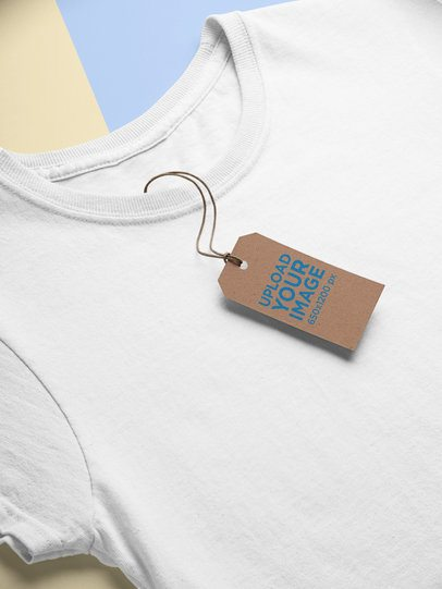 Mockup of a Cardboard Brand Tag Lying on a T-Shirt 27634