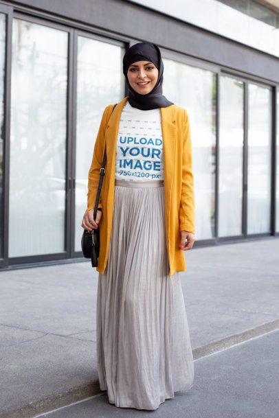 T-Shirt Mockup of a Woman With a Hijab Walking in the City 28297