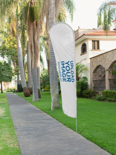 Mockup of a Flag Banner by a Sidewalk 28017
