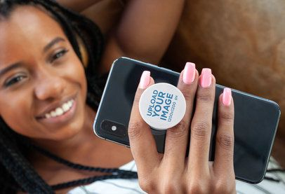 Phone Grip Mockup Featuring a Woman with Locks Lying on a Couch 28168