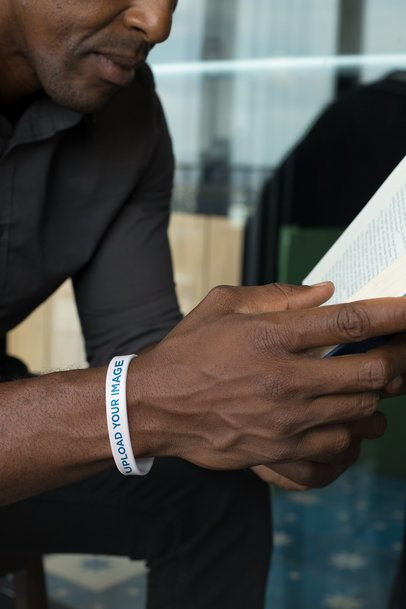 Silicone Wristband Mockup of a Man Reading a Book 28235