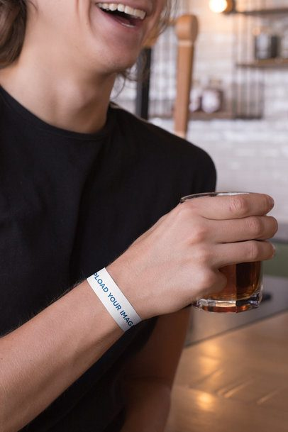 Paper Wristband Mockup of a Smiling Man Having a Drink 28250