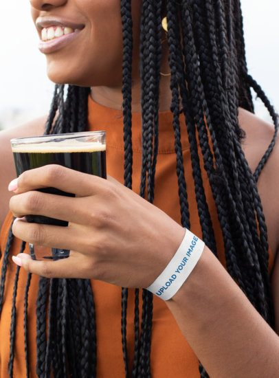 Paper Wristband Mockup Featuring a Woman Holding a Beer 28228