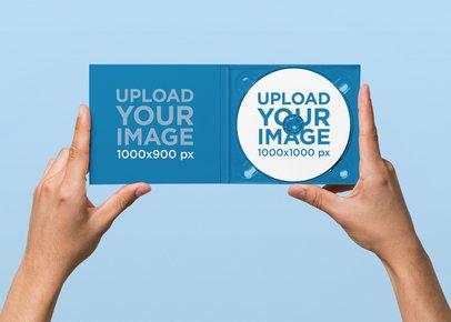 Minimal Digipak Mockup Featuring a Solid Color Backdrop 28333