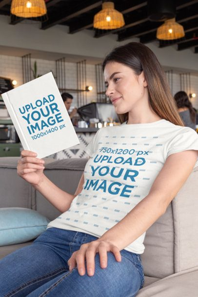 Mockup of a Woman Wearing a T-Shirt and Reading a Book at a Cafe 28480