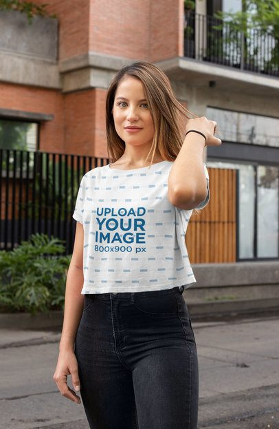 Crop Top Mockup Featuring a Long-Haired Woman Standing by a Brick Building 28552