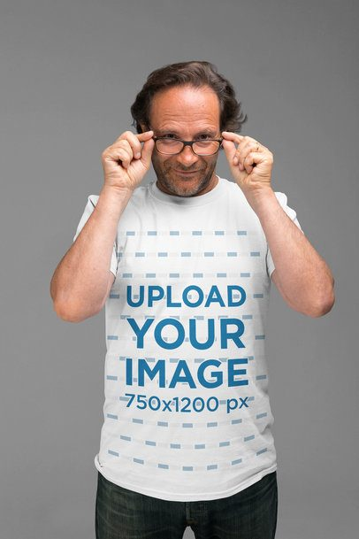 T-Shirt Mockup of a Man Holding his Glasses at a Studio 28436