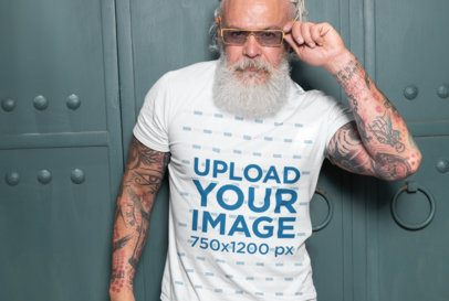 T-Shirt Mockup of a Fashionable Senior Man with Tattooed Arms 28426