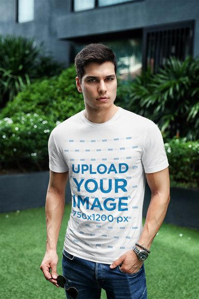 T-Shirt Mockup Featuring a Stylish Man Posing at a City Garden 433-el