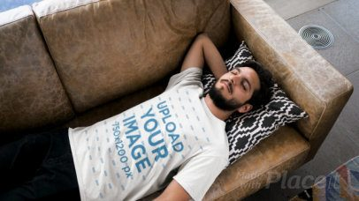 T-Shirt Video Featuring a Bearded Man Lying on a Couch 28921