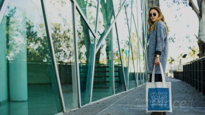 Video of an Elegant Blonde Woman Carrying a Tote Bag 13984