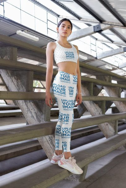 Sports Bra and Leggings Mockup of a Woman Standing on Concrete Grandstands 28714