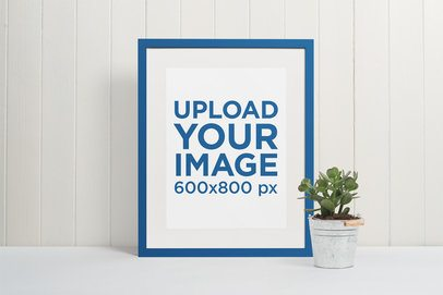 Minimalistic Mockup of a Picture Frame Leaning Against a White Wooden Wall 543-el