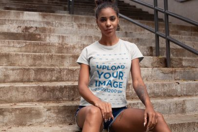 Heathered T-Shirt Mockup of a Woman Sitting on a Concrete Staircase 28639