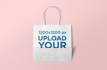 Gift Bag Mockup Displayed over a Minimalist Surface 648-el