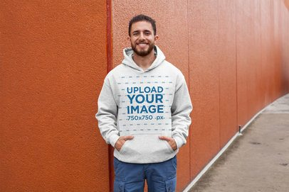 Hoodie Mockup of a Man Posing Against a Red Wall 28630