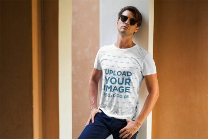 T-Shirt Mockup Featuring a Stylish Man With Sunglasses Leaning Against a Wall 508 el